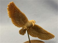 Stunning fossilized ivory carving of an eagle on h