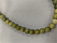 """About 18"""" strand of jade beads        (M 316)"""
