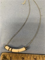 Small ivory pendant with silver alloy findings on