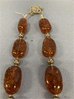 Choker style necklace made from large amber beads,