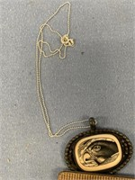 Fossilized ivory scrimmed pendant on silver toned
