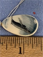 Lovely little scrimshawed ivory pendant with whale