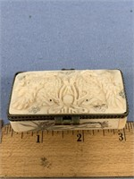"Scrimshawed fossilized bone pill box about 2.75"" l"