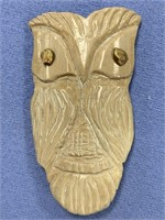 Fossilized ivory carving of an owl with small gold