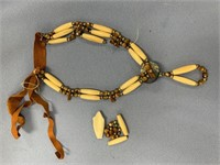 Parts and pieces of a beaded necklace containing s