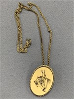 Small combination pin and pendant, with scrimshawe
