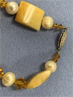 Tall glass stone and a cultured pearl beaded brace