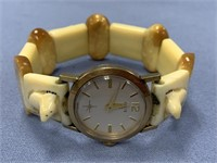Elgin watch 10kt gold casing, fossilized ivory str