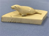Ivory carving of a seal on a fossilized mastodon t