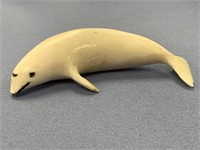 Ivory carving of a beluga whale, signed, about 3.5