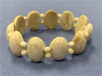 Stretch bracelet made from walrus teeth cabochons
