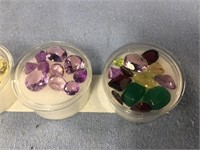 Lot of 4 containers of faceted semi-precious stone
