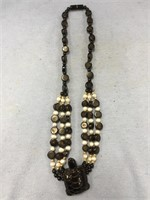 Necklace with beaded pendant made from black coral