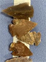 Lot of 9 reproduction flint arrowheads         (M