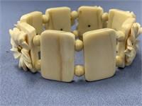 Ivory stretch bracelet with ivory floral carved de