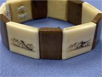 Scrimshawed ivory and fossilized ivory stretch bra