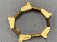 Carved ivory and fossilized ivory stretch bracelet