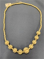 Ivory necklace with 9 carved ivory beads with inla