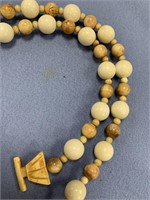 Fossilized ivory beaded necklace with traditional