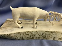 Ivory carving of 2 reindeer fighting mounted on sl