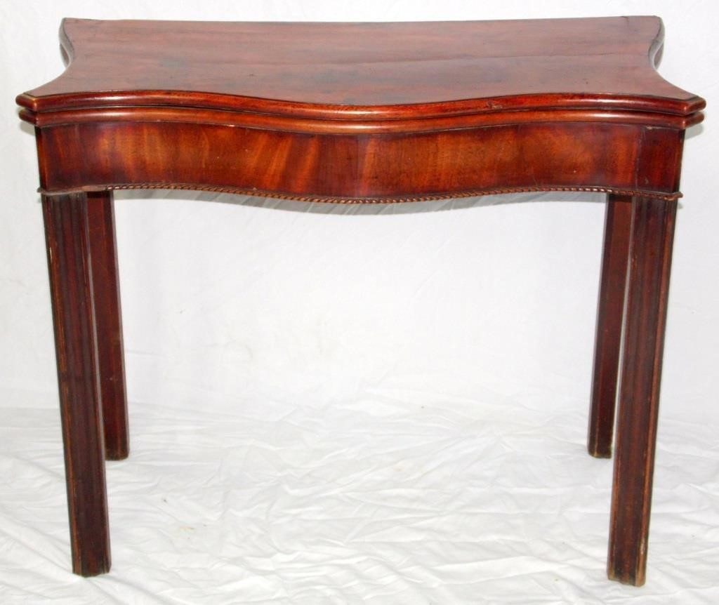 George III Mahogany Serpentine Card Table. 18th Century. The folding top reveals a shaped green baise playing surface,over a plain frieze with beaded edge decoration, all supported on moulded square legs. Height 29.5 in. Width 36 in. Depth 18 in.
