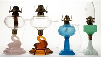 Seven swan-base lamps and other early kerosene lamps