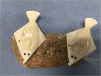 2 Ivory halibut on fossilized whalebone base with