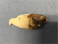 Fossilized walrus tooth carved into eagle's head 2