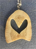 Fossilized ivory platchet pendant with 2 swans rel