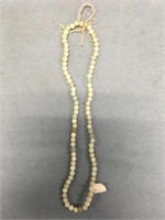 """Approximately 10"""" closed strand of stone beads"""