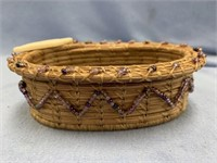 Lost Feather hand woven grass basket made from Geo