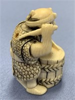 """Japanese ivory netsuke of a man and his drum 1.5"""""""