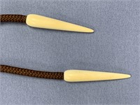 Fossilized ivory platchet bolo tie with
