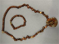 Stone and freshwater pearl beaded necklace with