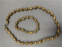 "Lovely 18"" strand of freshwater pearls with metal"