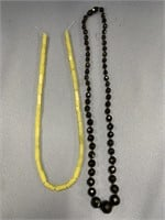 Lot of 2 necklaces, 1 is plastic beaded, other is