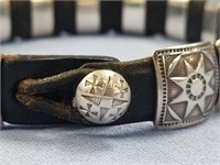 Leather bracelet with 15 sterling silver pieces, c