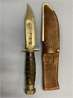 Vintage Camillus fighting knife with stacked leath