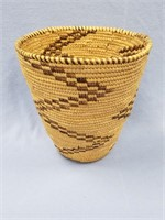 Hand woven grass basket, with brown dyed accents,
