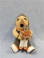 Hand crafted pottery piece with mother and child