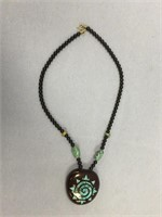Beaded necklace with glass turquoise bead spacers