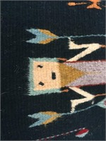 Piece of Native American woven artwork, featuring