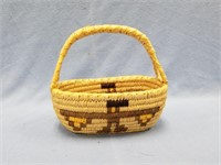"Small hand made grass basket with handle 7"" tall"