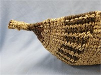 """Hand woven basket in the shape of a canoe 20"""""""