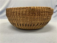 """Hand woven basket, about 10"""" long, rim has sustain"""