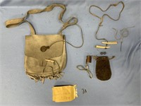 Leather shoulder bag, contains some gun pieces and