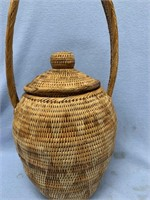 Interesting lidded woven basket with intricately w