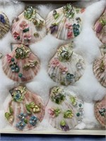 Box of 12 sea shells, with additional floral desig