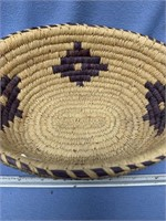 "Hand woven grass basket with dyed accents, 9.75"" d"