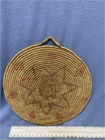 Old woven wall hanger with dyed accents, has fraye